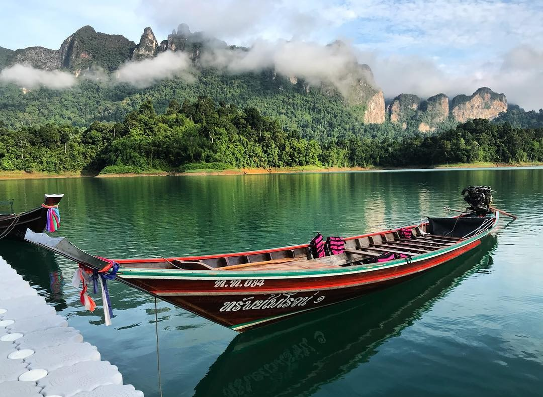 longtail boat moored on Cheow Lan Lake with the limestone rocks in the background