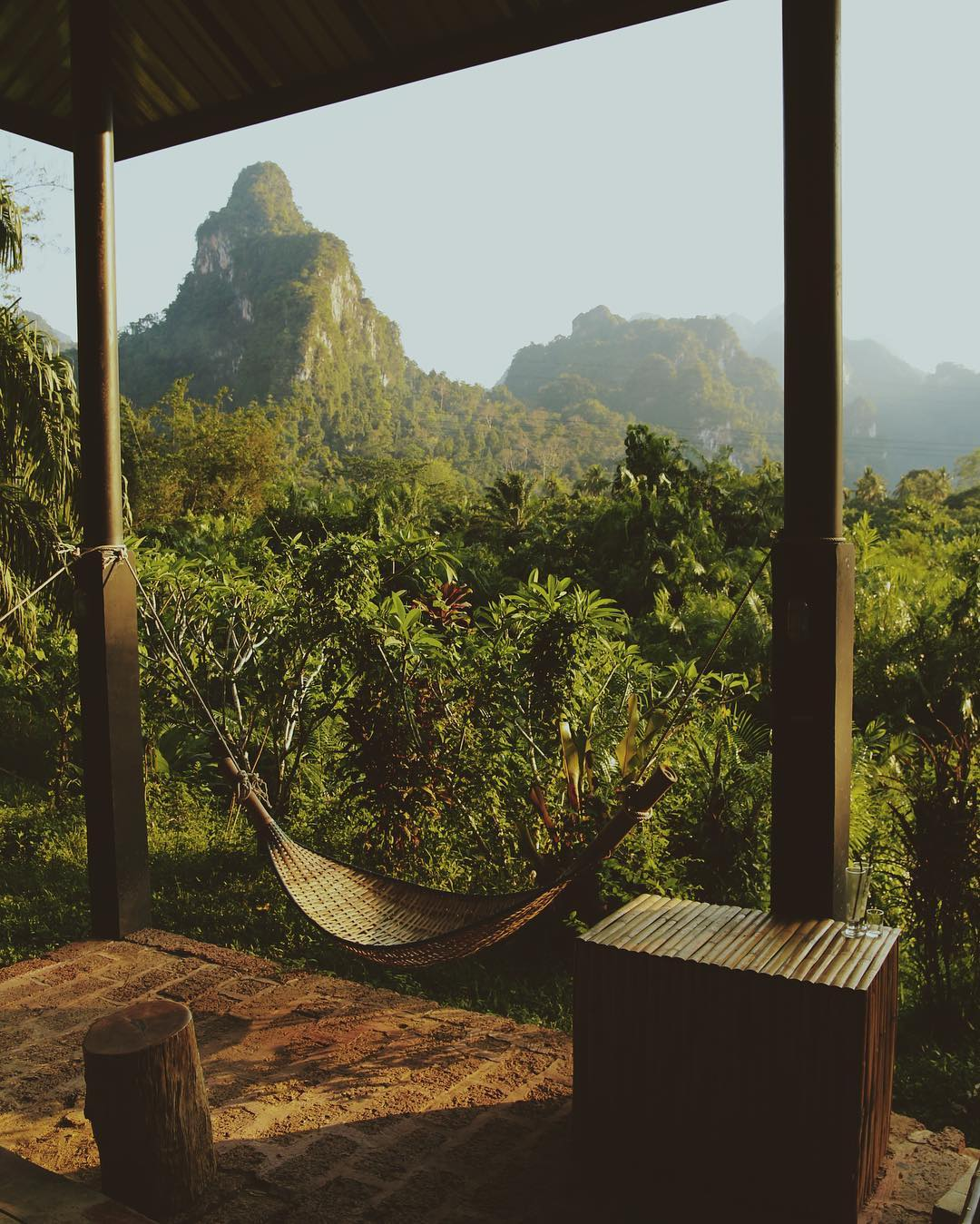 Cottage with hammock overlooking the limestone mountains of Khao Sok National Park