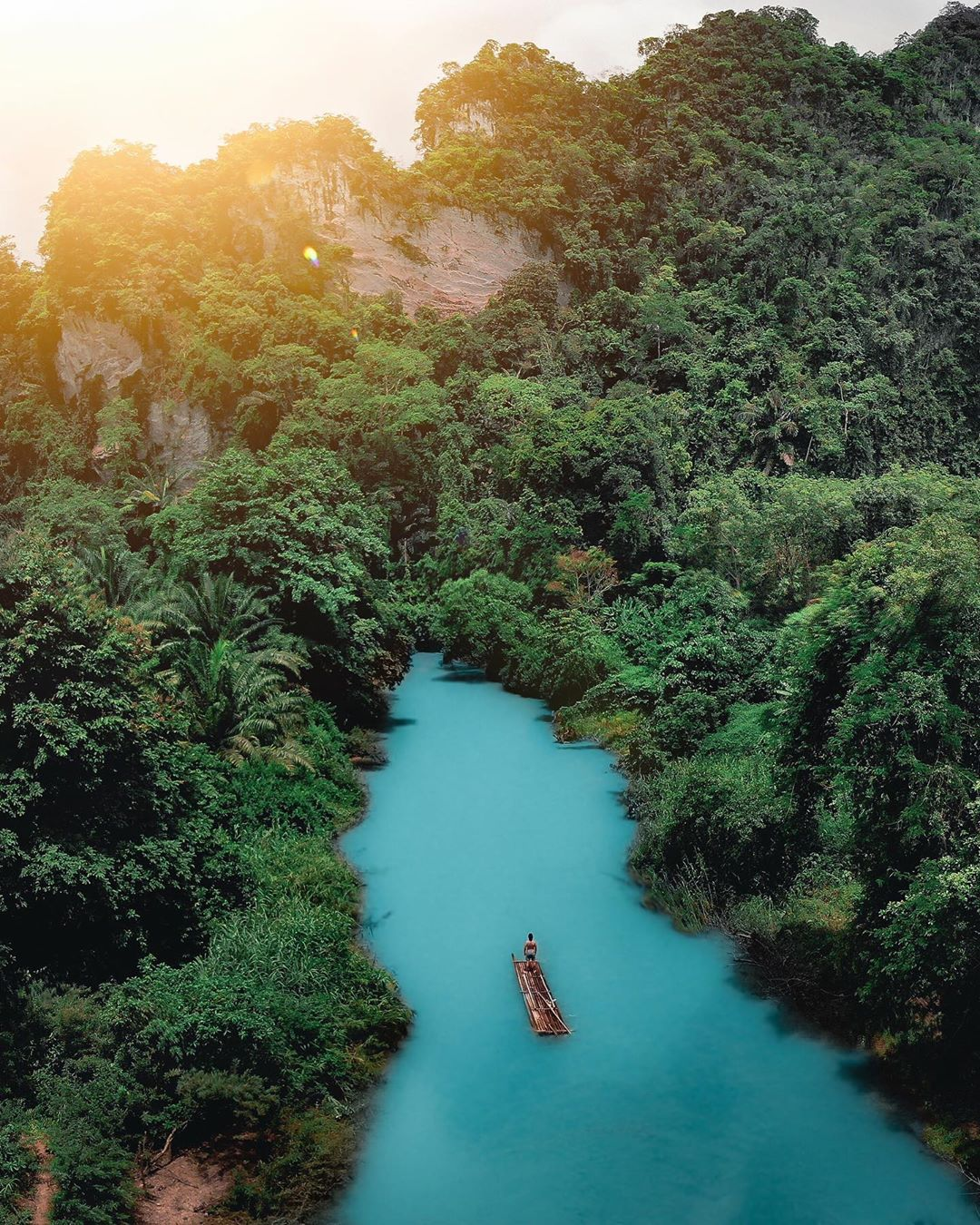 An old canoe on Cheow Lan Lake overlooking the jungle. Image was taken with a drone