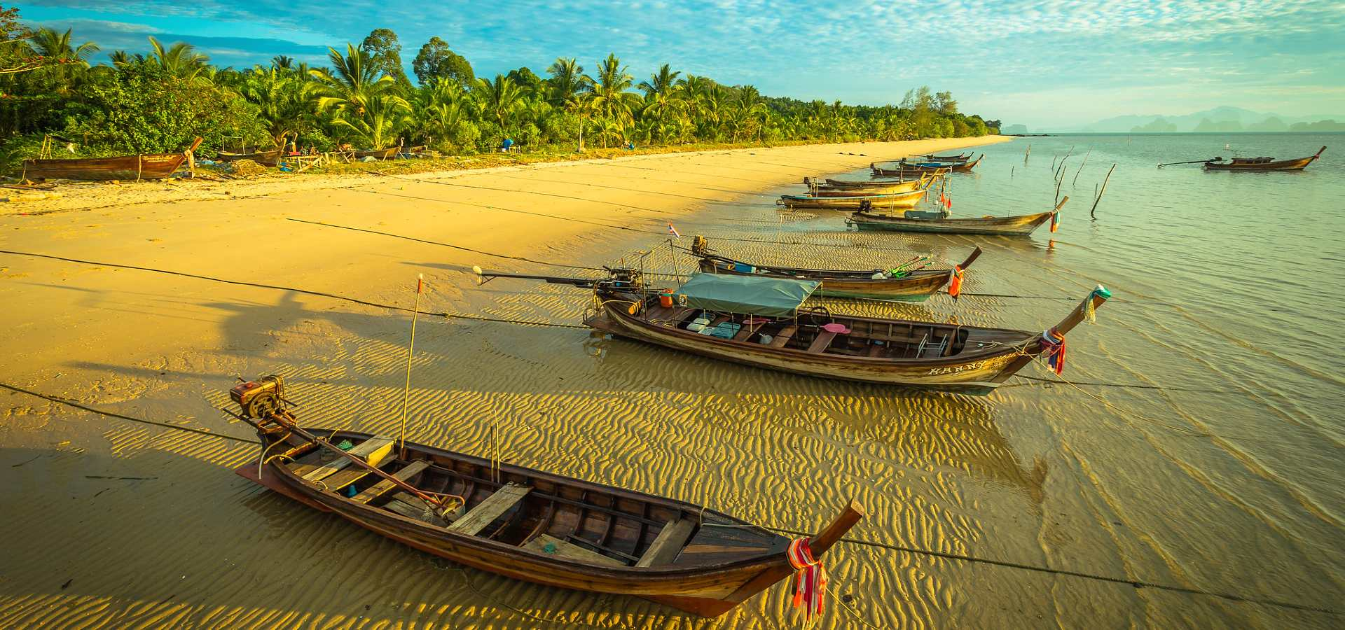 Koh Yao Yai longtail boats at the beach