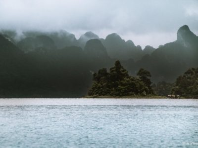 On The Background Clouds Over The Mountains Of Khao Sok And Cheow Lan Lake With Rain In The Foreground