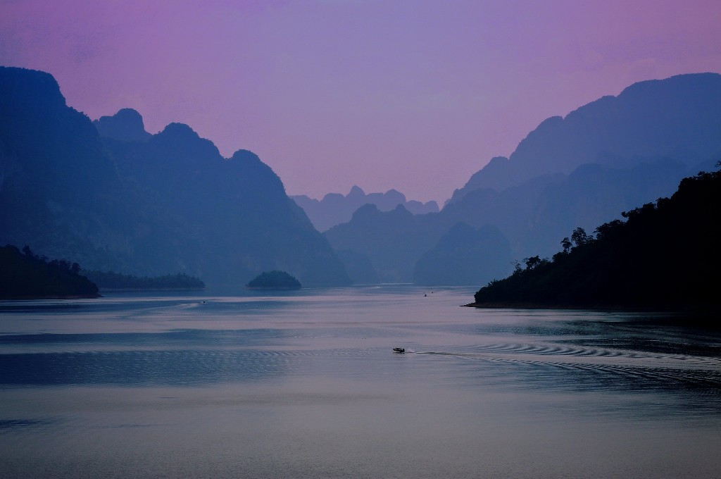 Pink glow in the sky overlooking the Cheow Lan Lake of Khao Sok National Park in Thailand