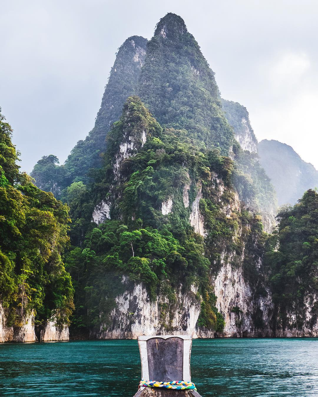 Large limestone rock seen from a longtail boat in Cheow Lan Lake