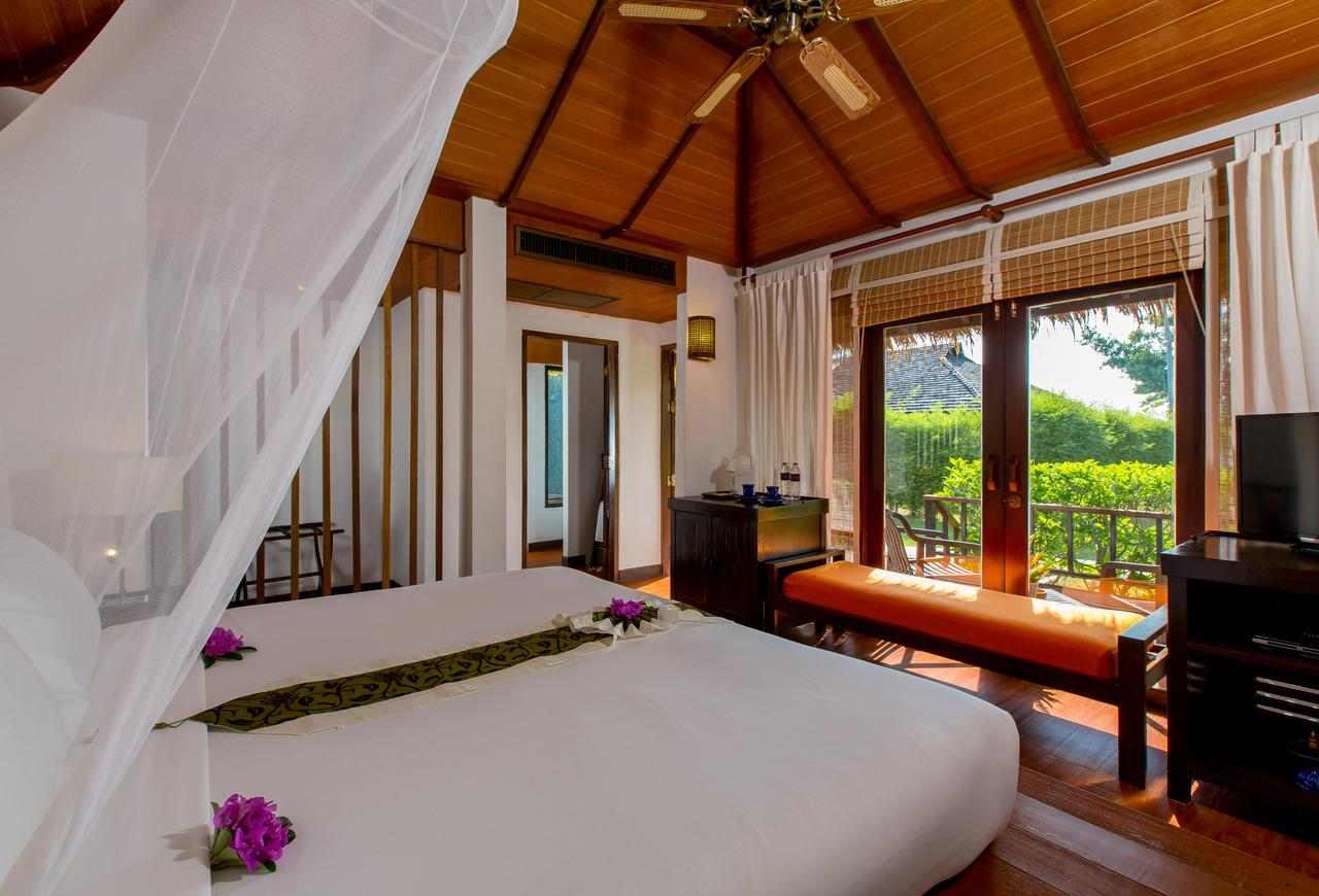 Slaapkamer van het GLOW Elixir Resort