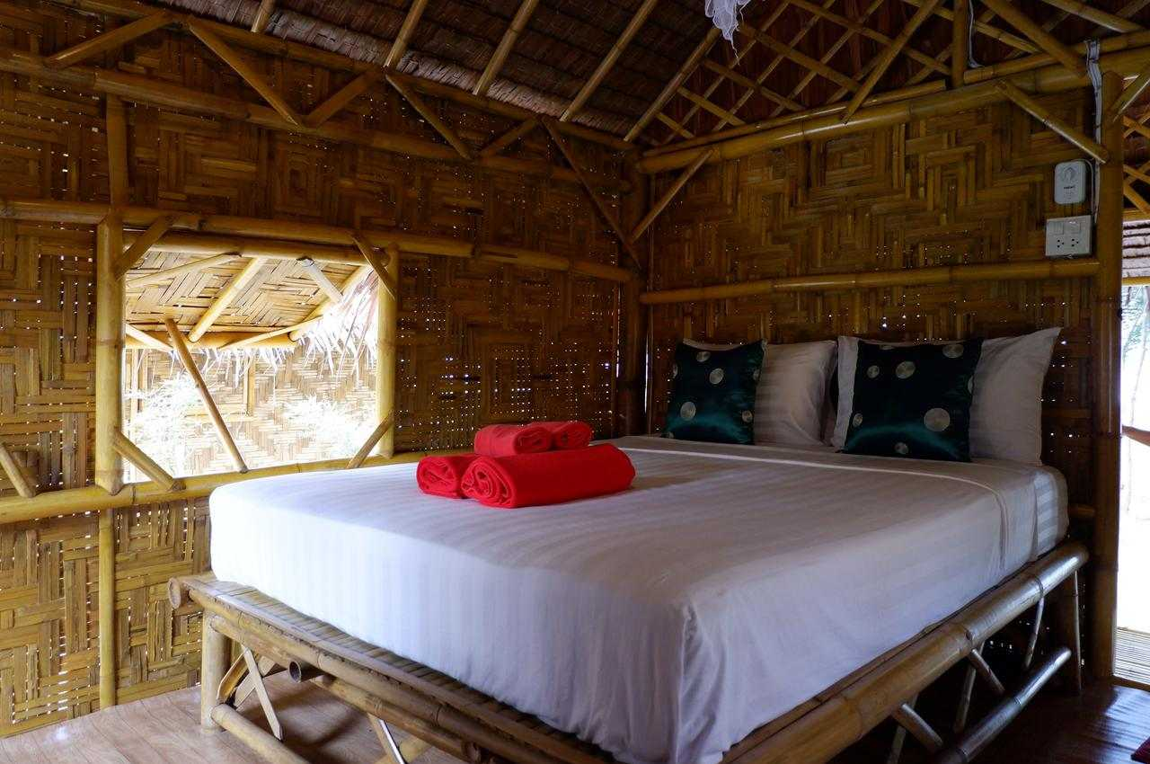 The inside with double bed of the simple bungalow of Koh Yao Beach Front