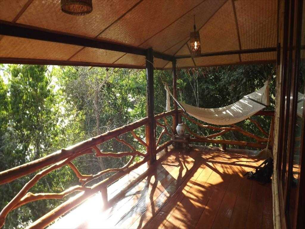 The terrace with hammock of a bungalow of the Viking Nature Resort on Koh Phi Phi