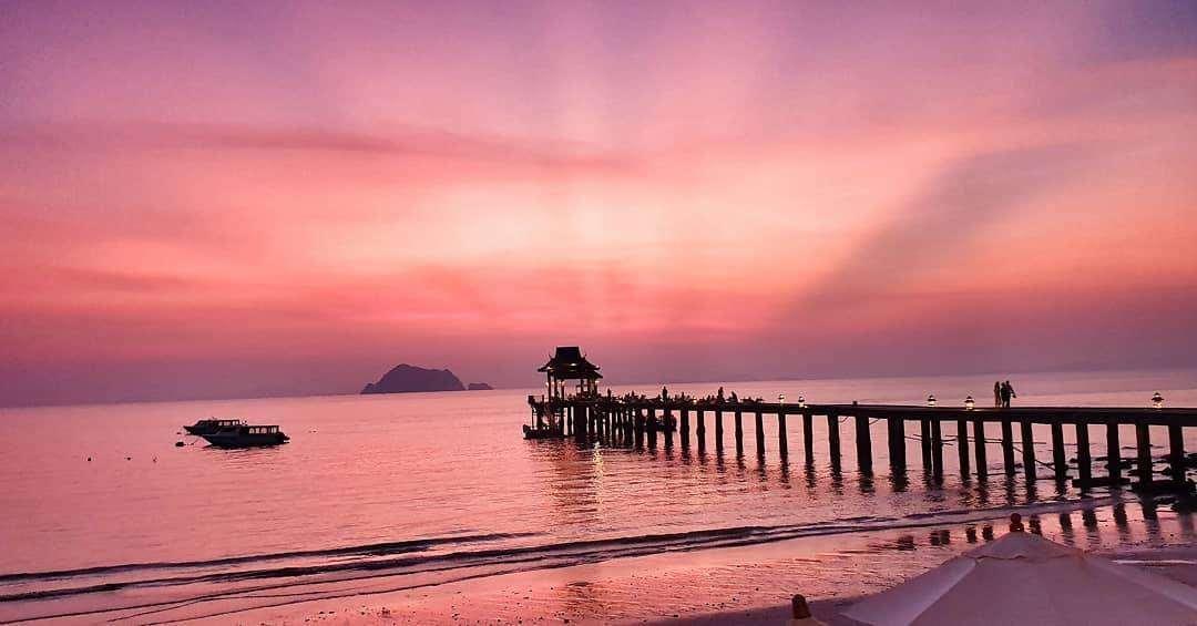 Jetinn Teppan Pier on Koh Yao Yai while the sky turns pink