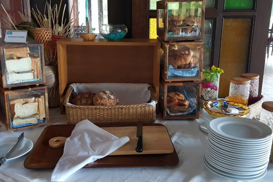 Different types of bread with toppings at breakfast of GLOW Elixir