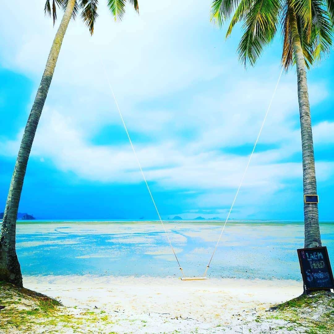 Swing on white beach on Koh Yao Yai