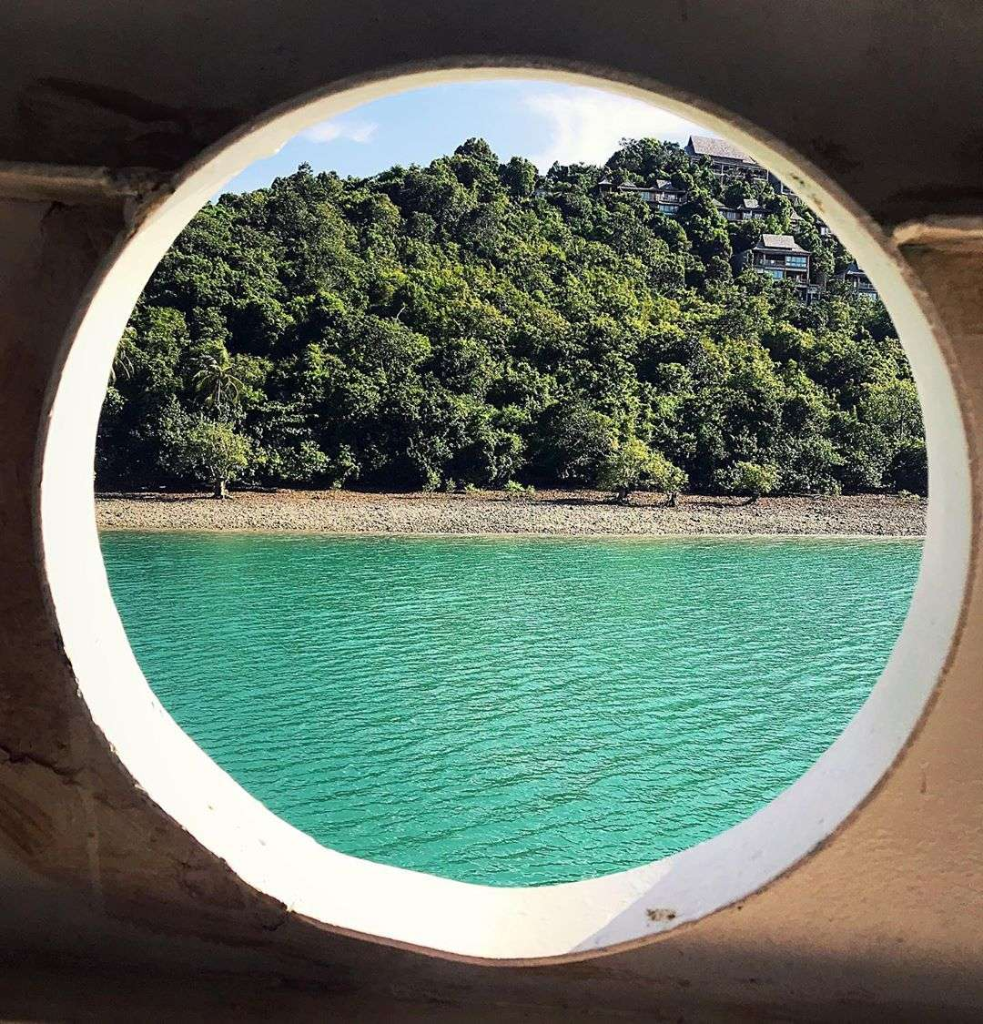 Koh Yao Yai seen from a ship - through a large round hole
