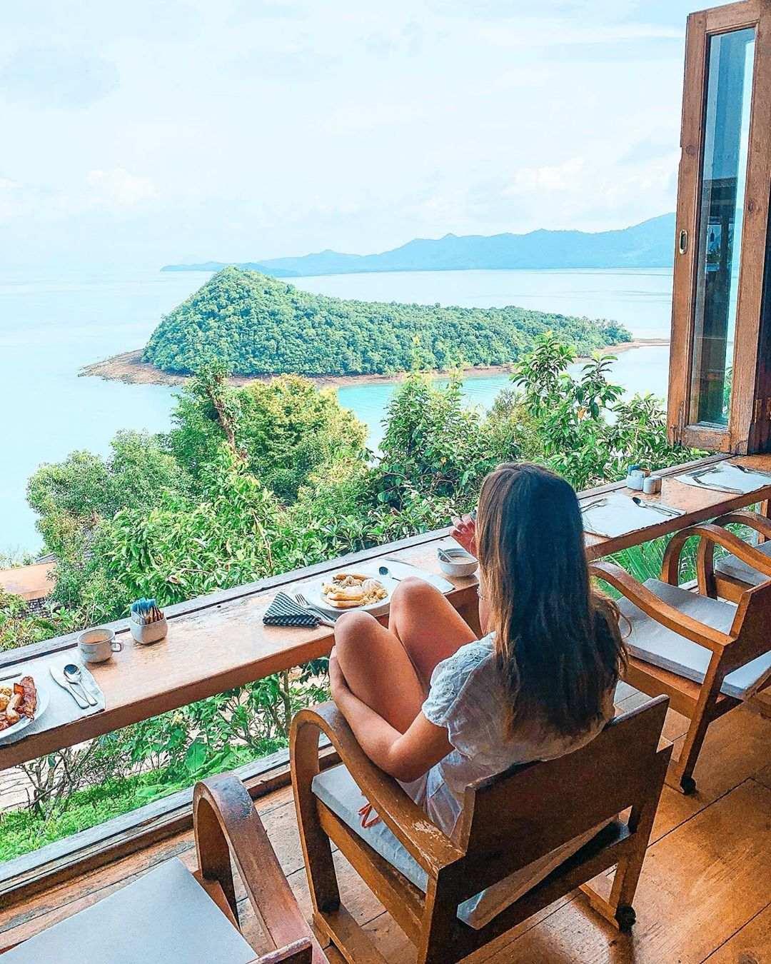Girl having breakfast at the Santhiya Koh Yao Yai Resort & Spa