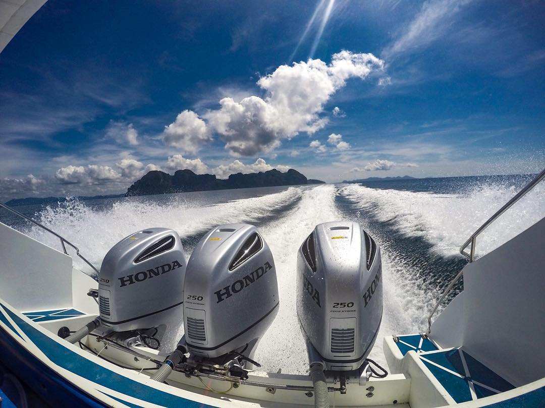 The powerful engines of a speedboat in the Andaman Sea of Thailand