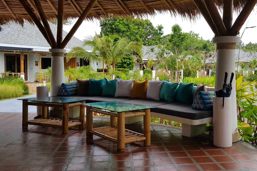 A large sofa at the reception of Lanta Casa Blanca on Koh Lanta