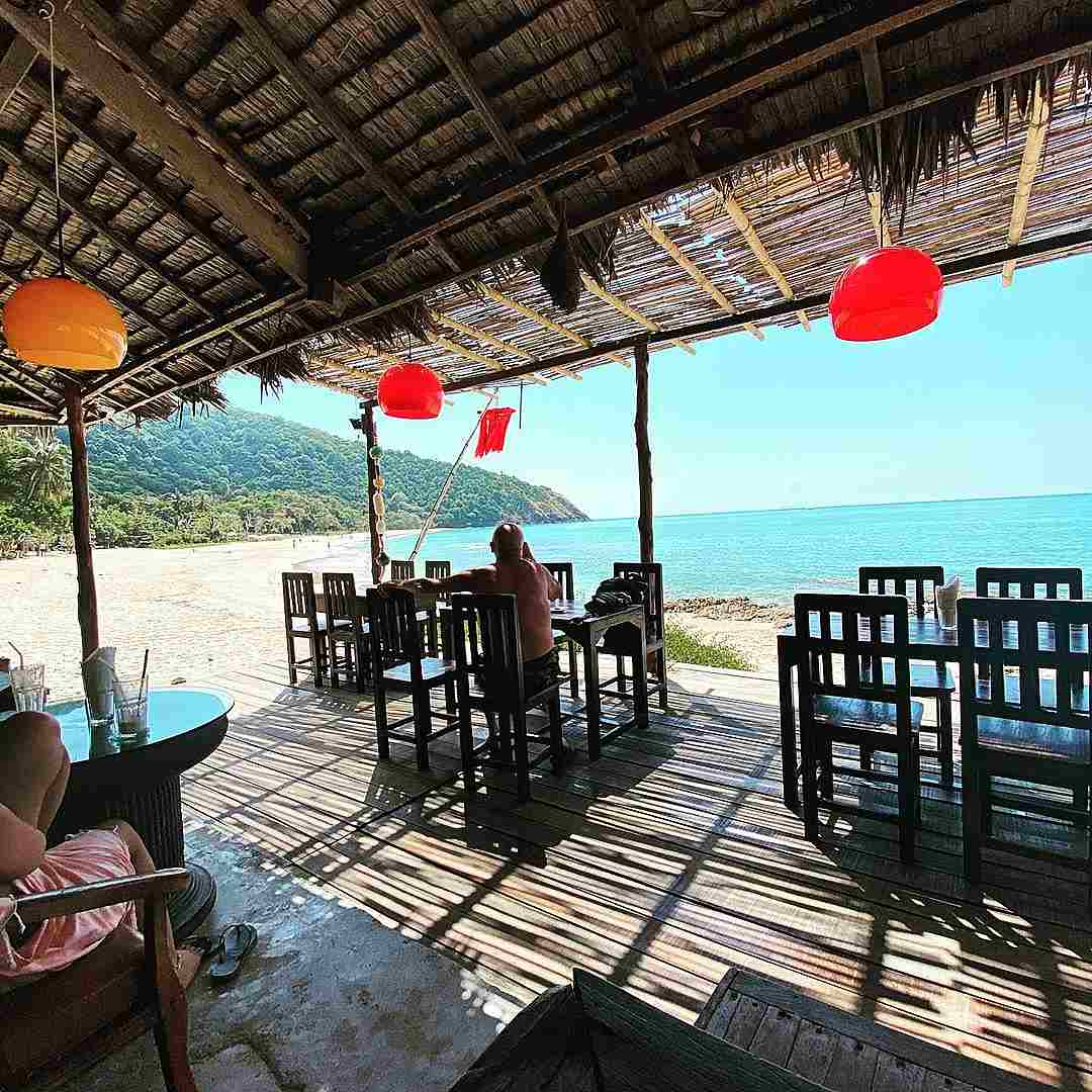 Bamboo Beach Restaurant overlooking clear sea and white beach