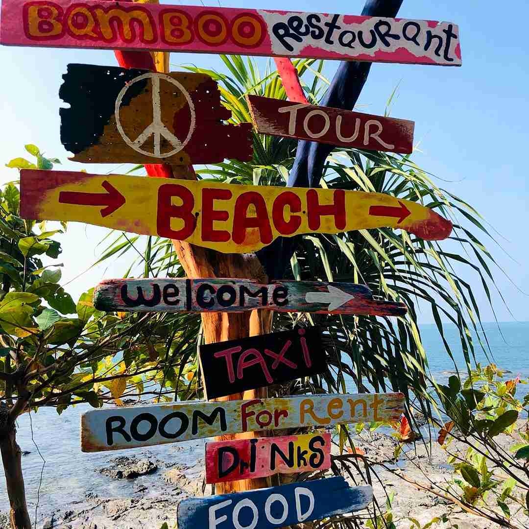 Maiphai Bay, colorful signpost to the beach and restaurant