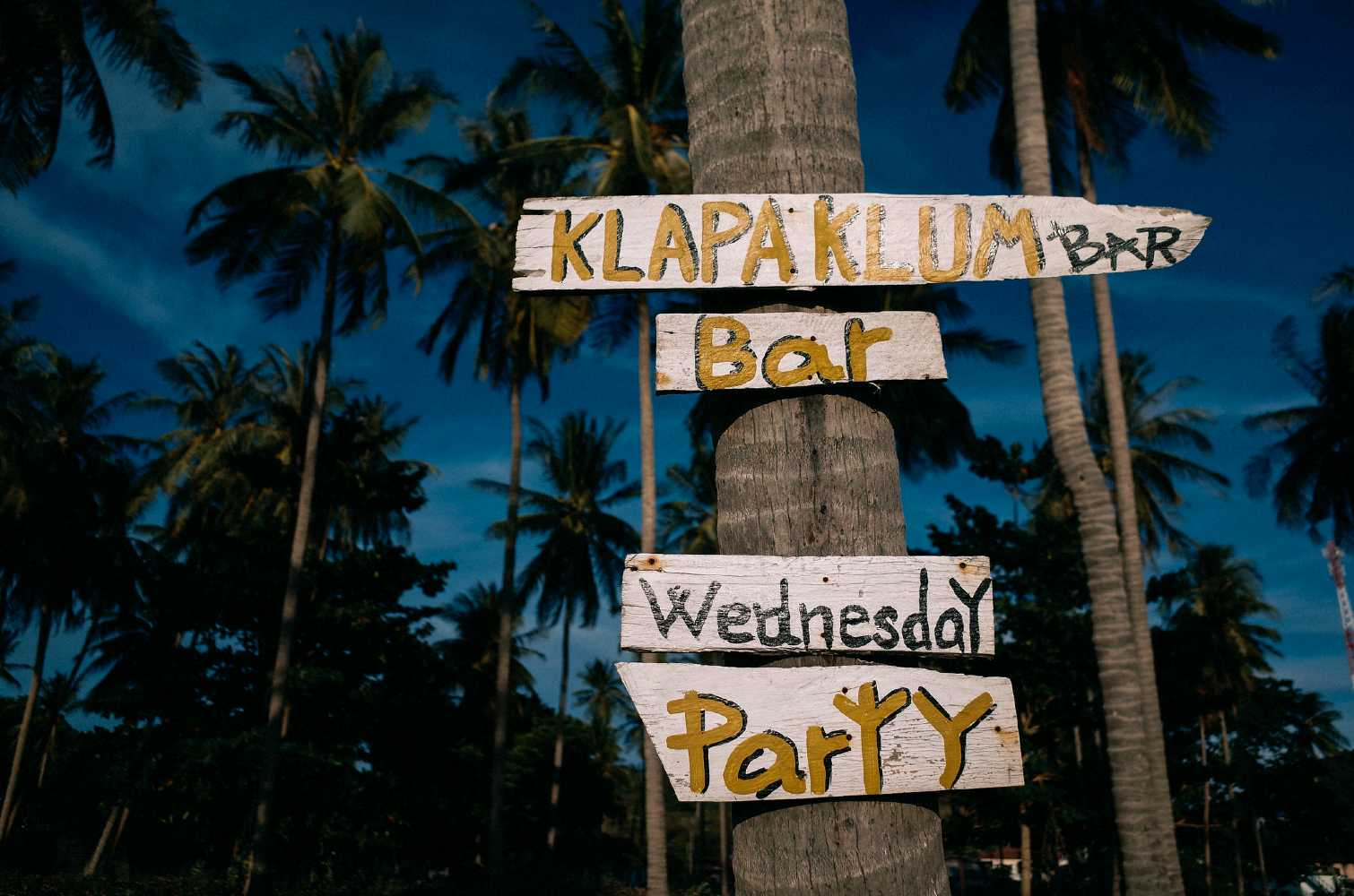 Signs announcing where to go out on Koh Lanta