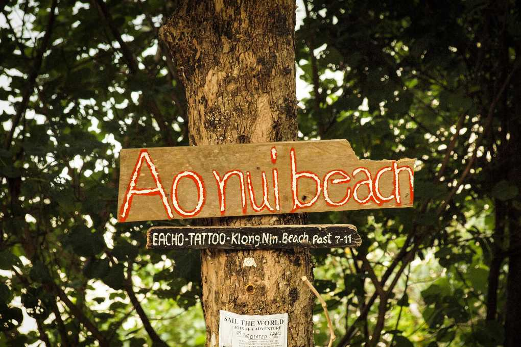 Ao Nui Beach sign on the beach of Koh Lanta in Thailand