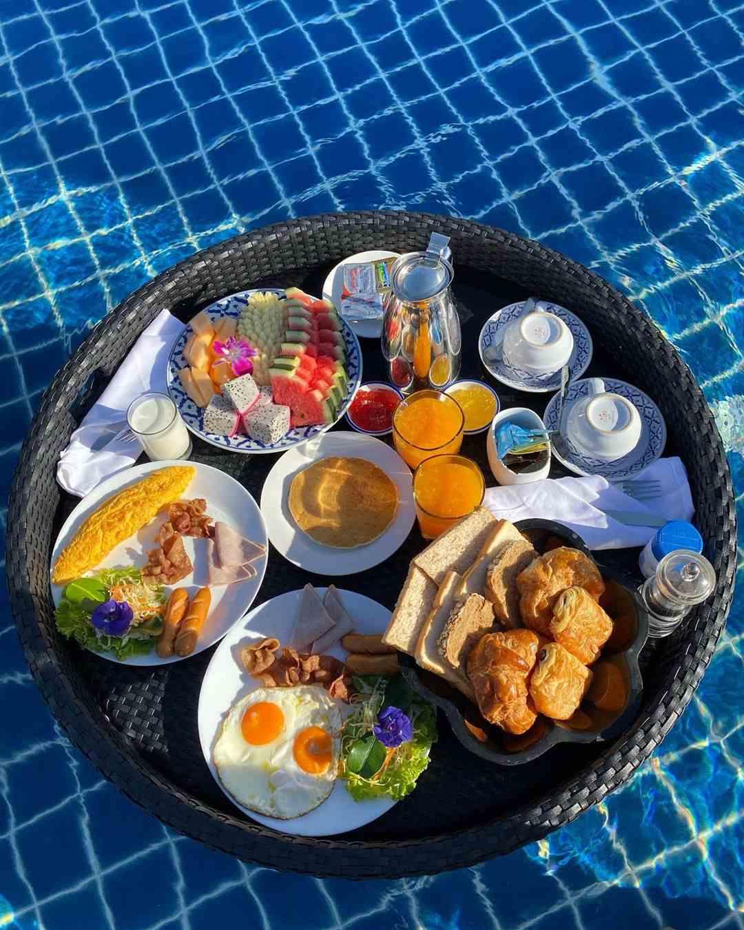 Floating Breakfast in the pool of Lanta Casa Blanca on Koh Lanta, Thailand