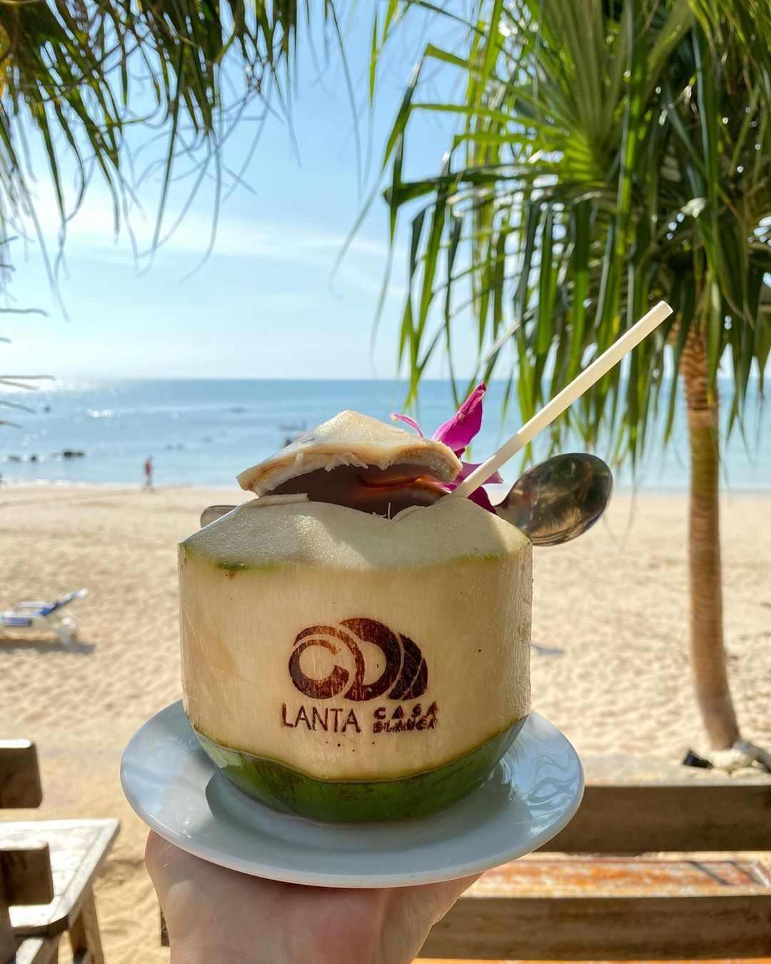 Coconut with Lanta Casa Blanca logo burned on it at Relax Bay Beach on Koh Lanta
