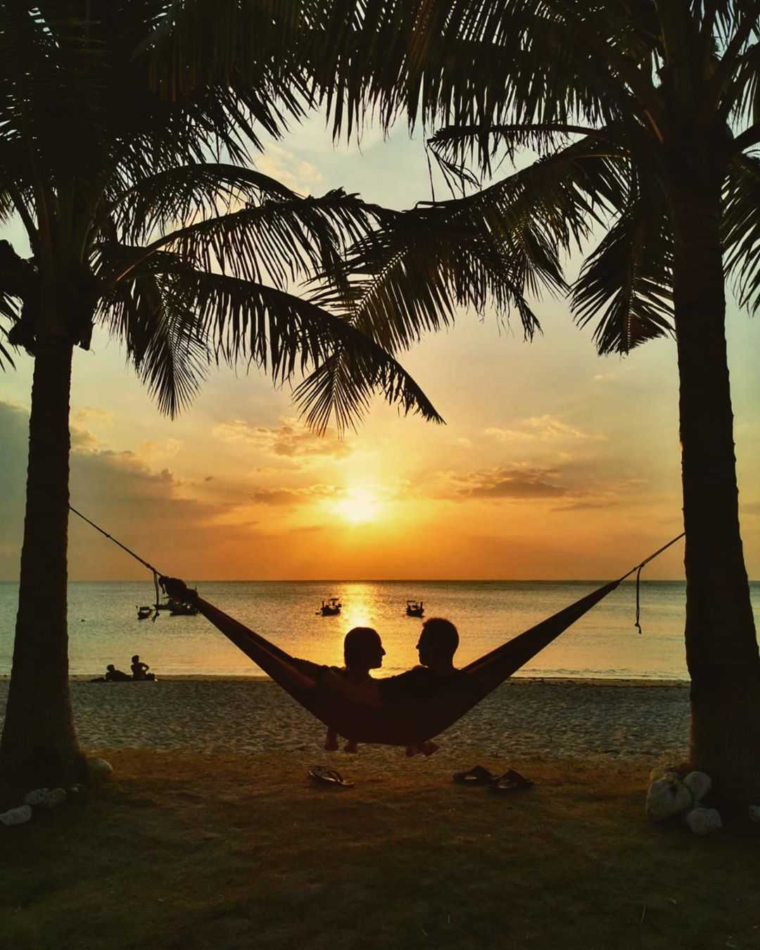 Hanging out in a hammock on the beach of Koh Lanta while the sun sets
