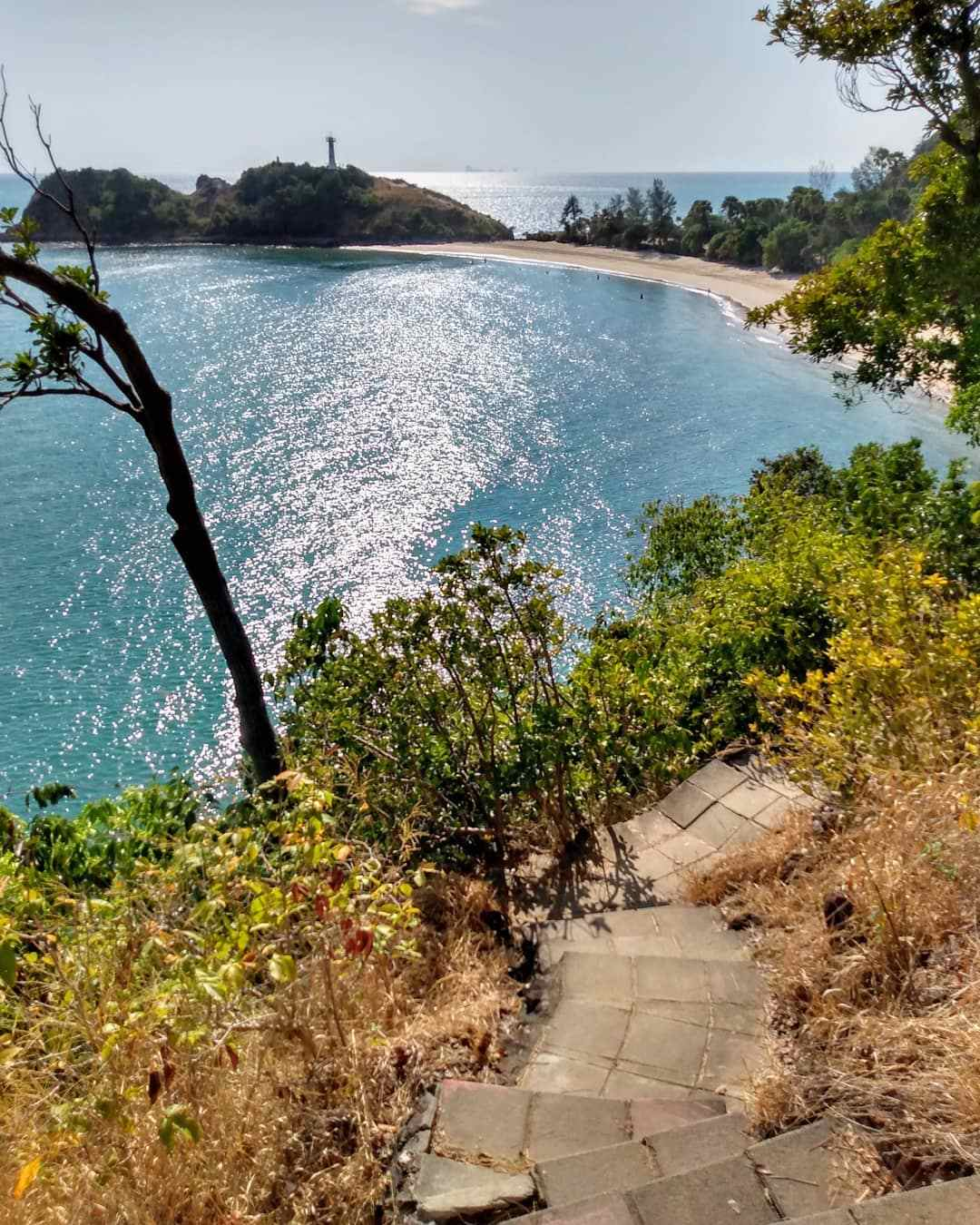 View of the lighthouse and the beach of Mu Koh Lanta National Park in the distance