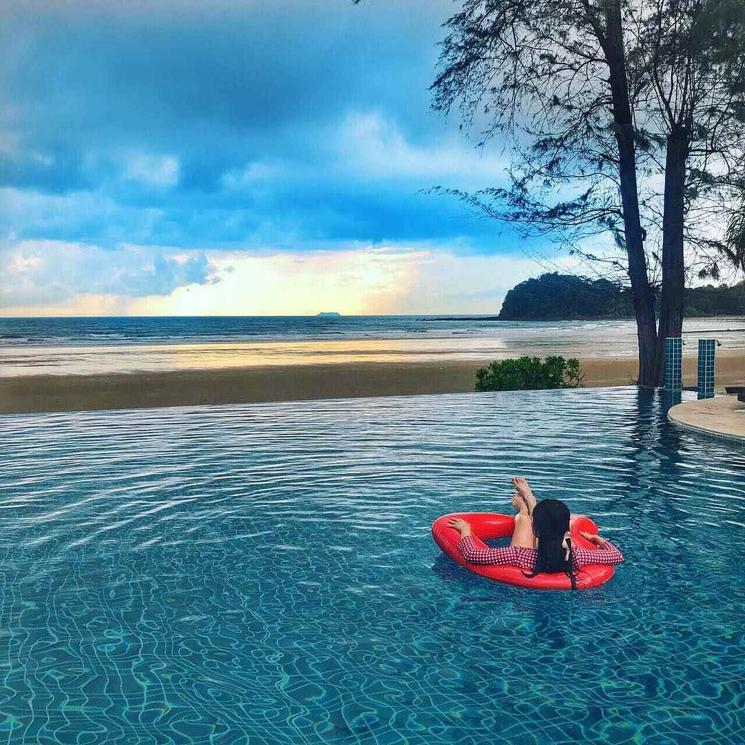 Chill out in the pool at Twin Lotus Resort on Koh Lanta