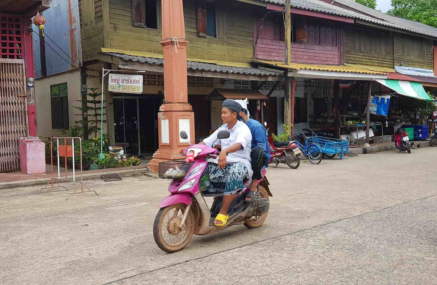 Old Town Koh Lanta, Thai-Muslim on a scooter ride through the village