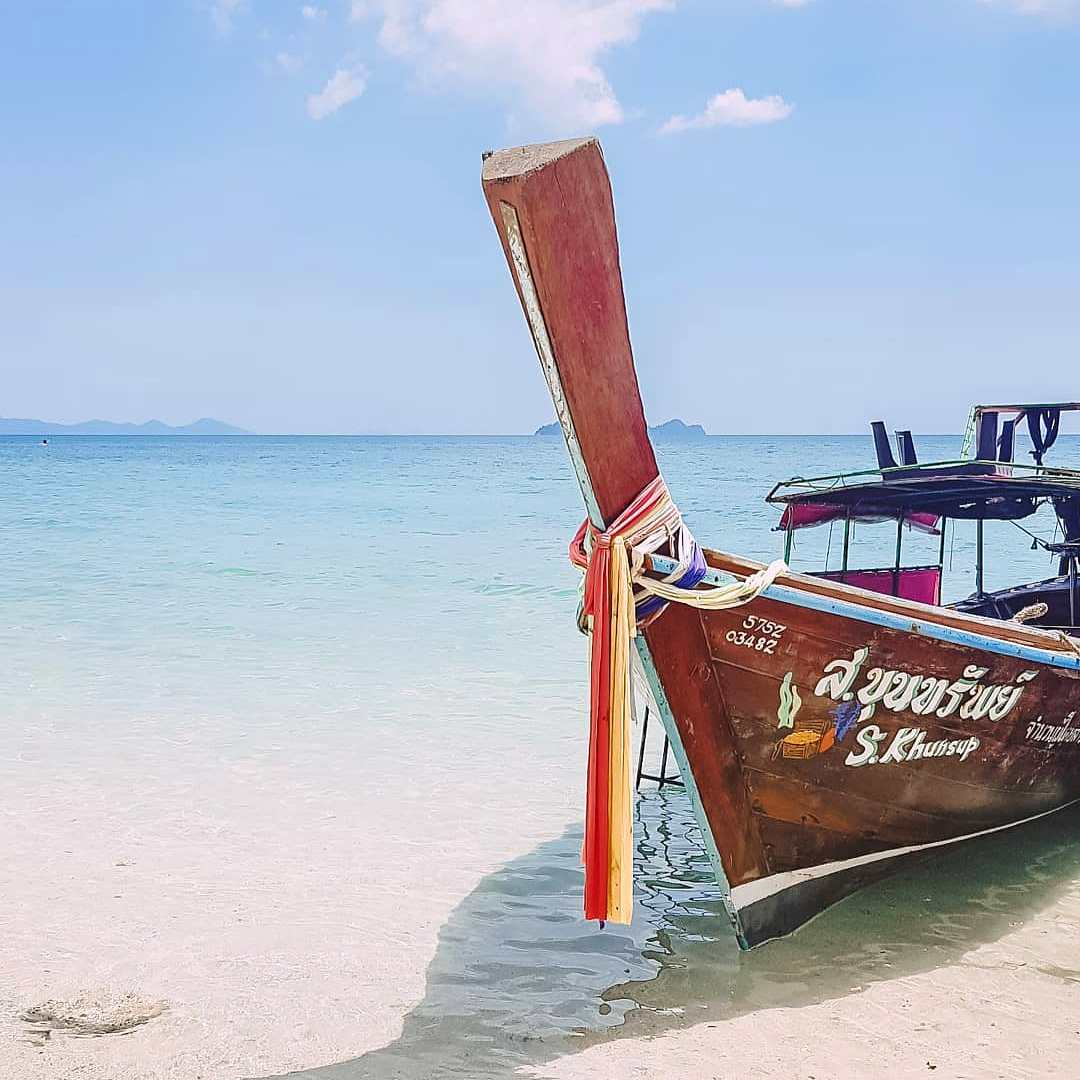 Saladan Longtailboat in the clear sea at Koh Gnai