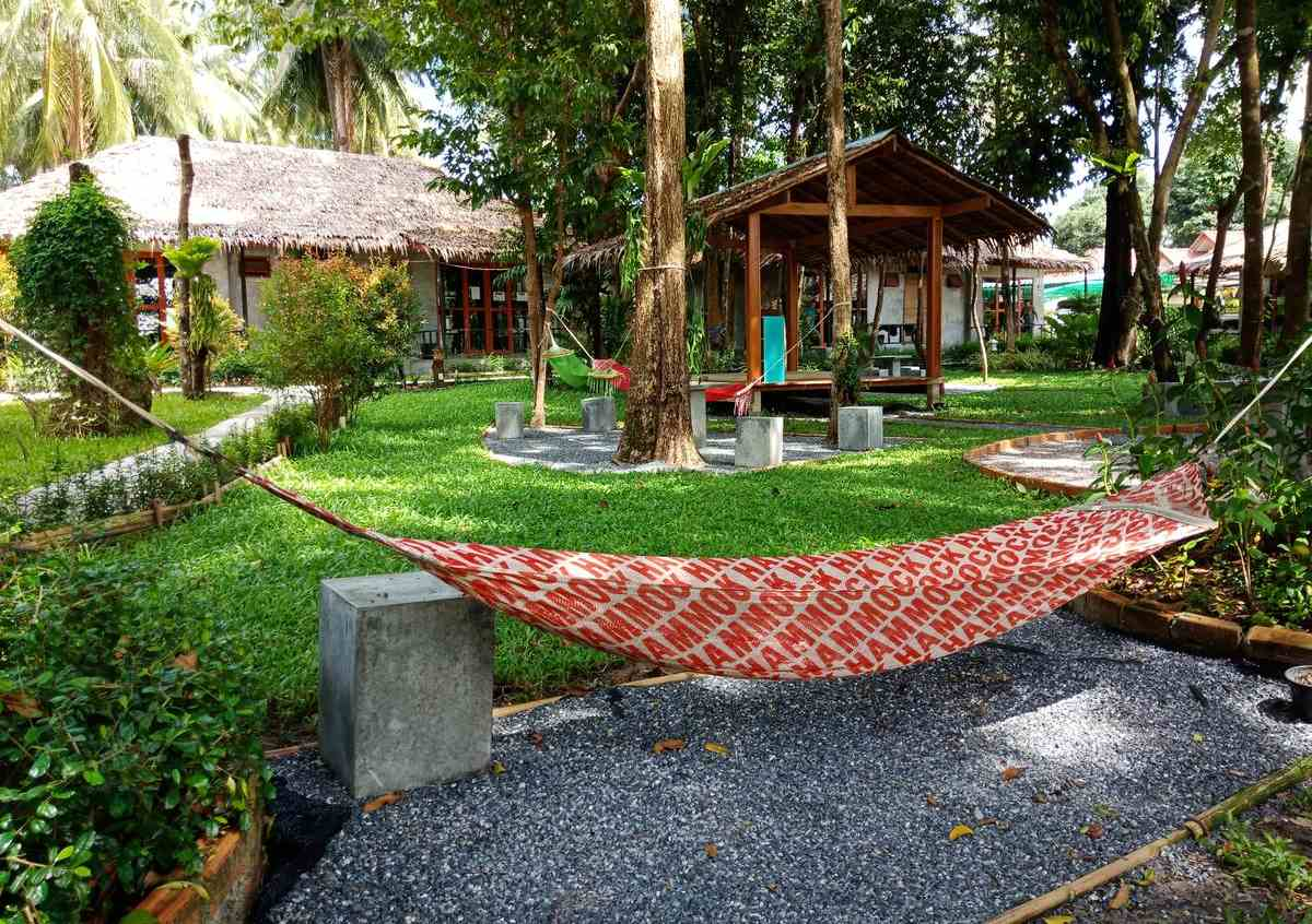The garden with hammock of Blanco Hostel at Lanta, one of the best cheap places to sleep on Koh Lanta