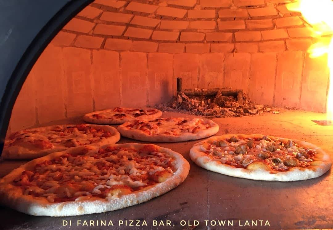 Pizzas in a wood-fired oven at Di Farina Pizza Bar in Koh Lanta's Old Town, one of the best restaurants on koh lanta!