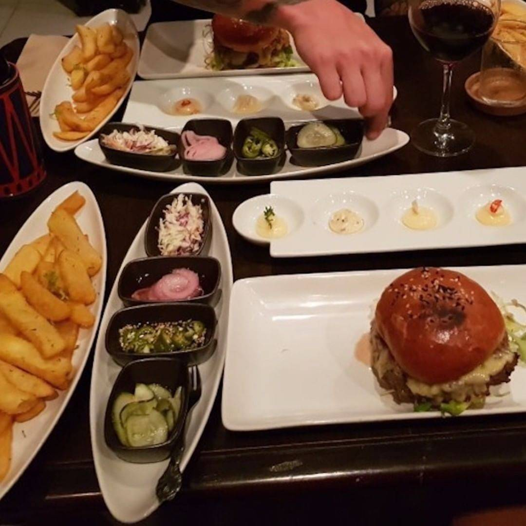 Super good burgers with sauce and toppings separately at Global Local, Home of the serious Burger in Saladan Koh Lanta, one of the best restaurants on koh lanta!