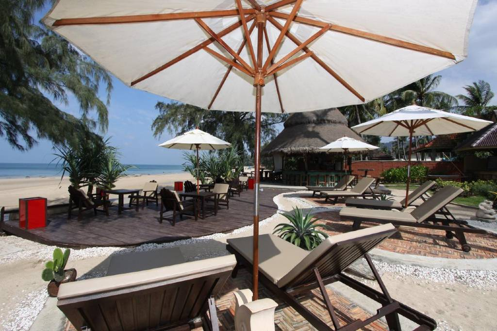 Sunbeds and chairs on the beach at Lanta Castsway Beach Resort, Best mid-range hotels on Koh Lanta