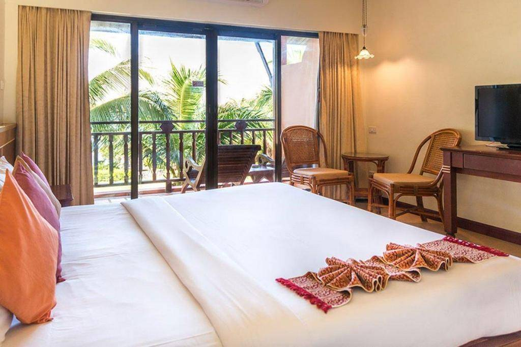 Bedroom with balcony of the Lanta Casuarina Beach Resort. one of the best cheap places to sleep on Koh Lanta