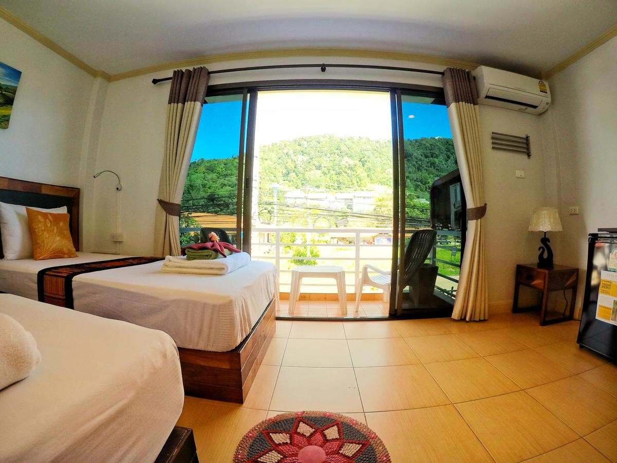 Twin room with balcony from Lanta@Home, one of the best cheap places to sleep on Koh Lanta