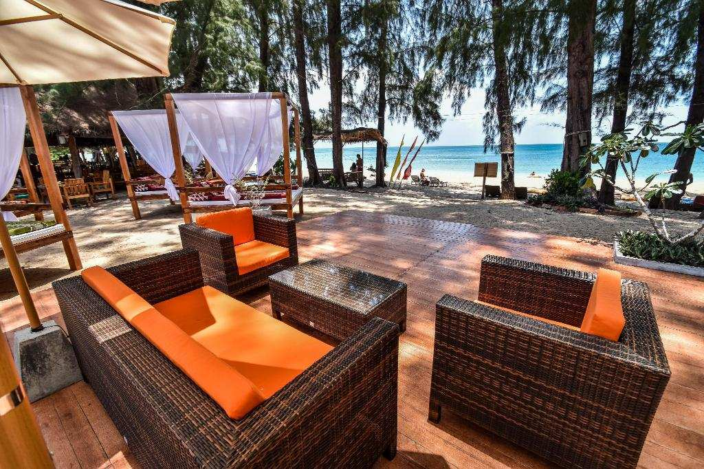 Enjoy lounging outdoors at Long Beach Chalet, one of the Best Middle Class Hotels on Koh Lanta