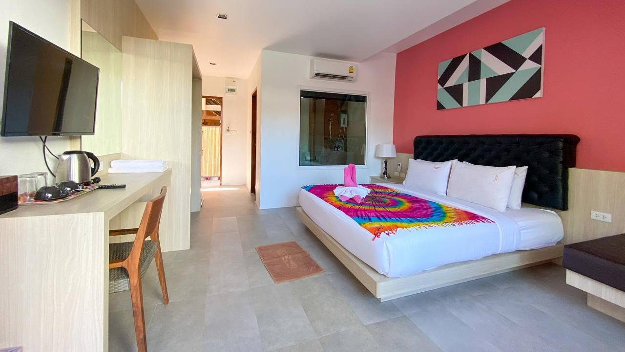 The bedroom of the Pinky Bungalow Resort, one of the best cheap places to sleep on Koh Lanta