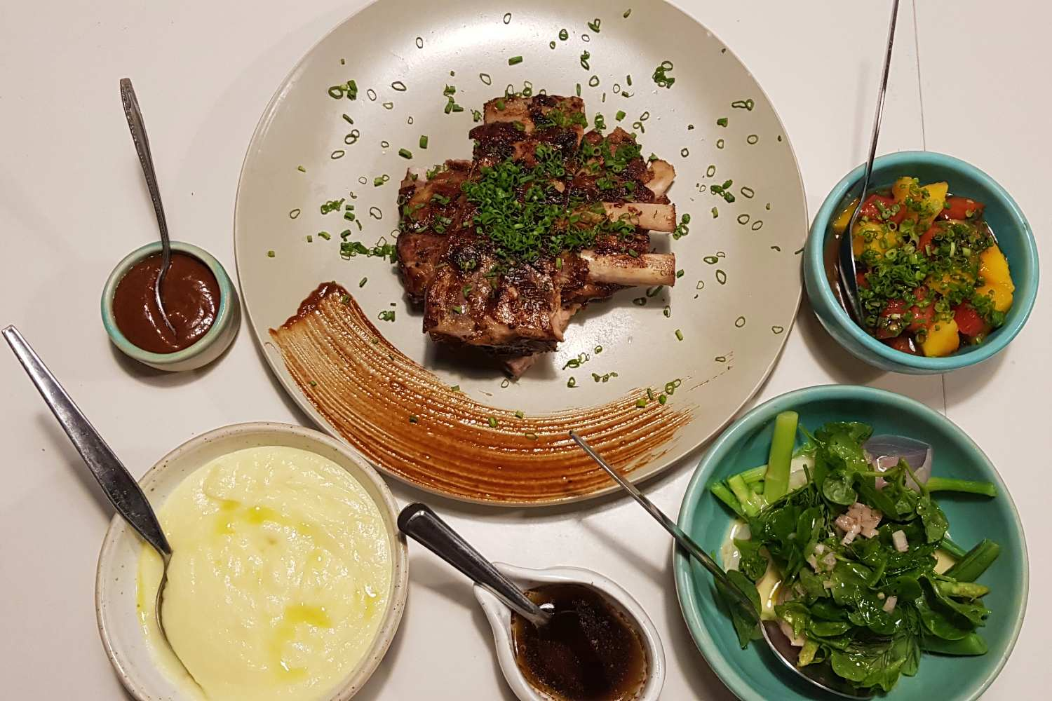 Spareribs with various side dishes and homemade sauces at Yang Garden, one of the best restaurants on koh lanta!