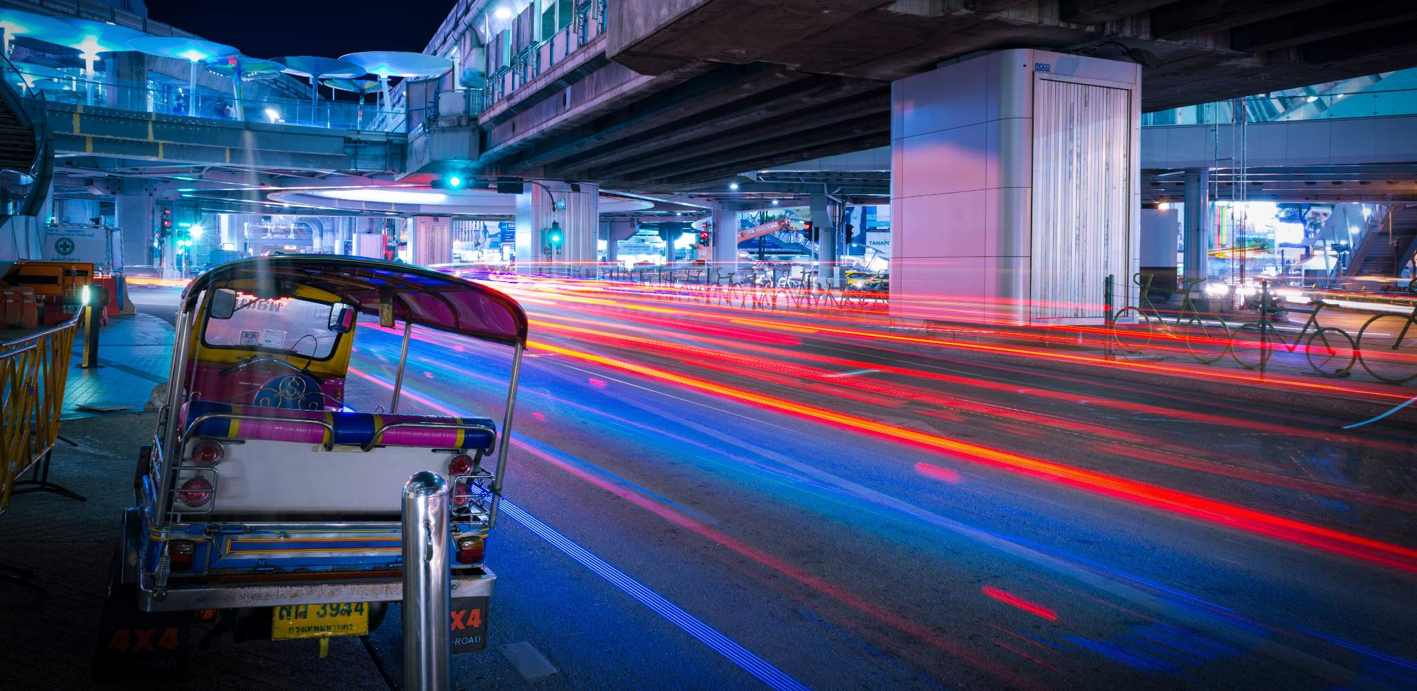 Tuk tuk along the road in Bangkok during the evening, picture taken with long shutter speed.