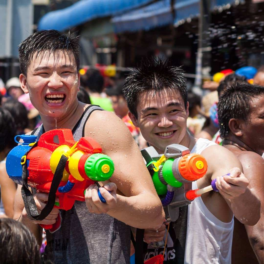 Two young men having fun at Songkran in Thailand
