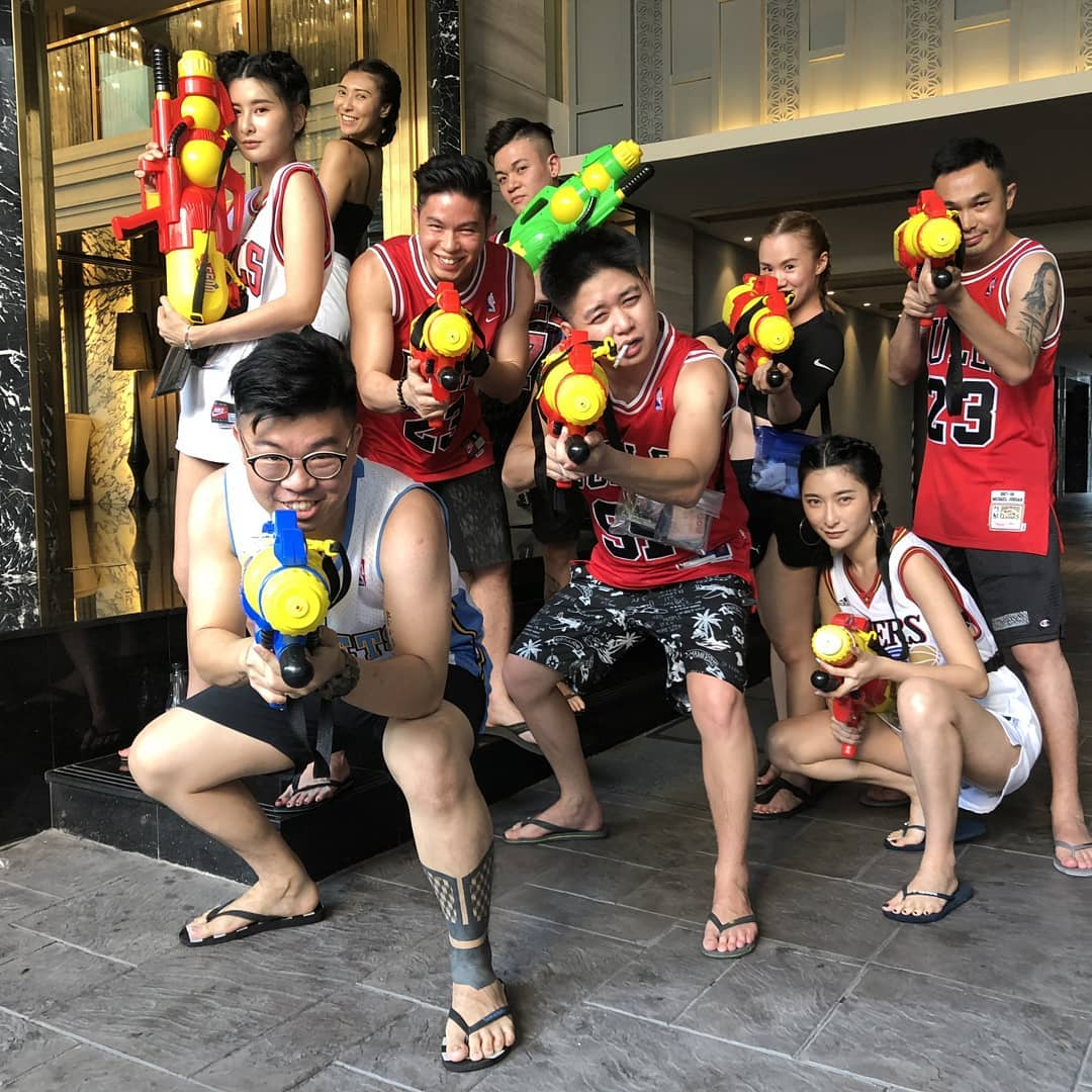 Group of youngsters ready for the water fight during Songkran in Thailand