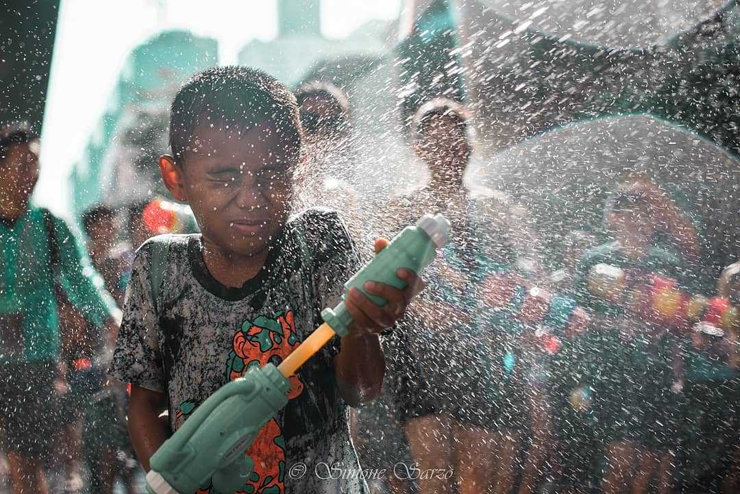 Wet sprayed boy during Songkran in Thailand