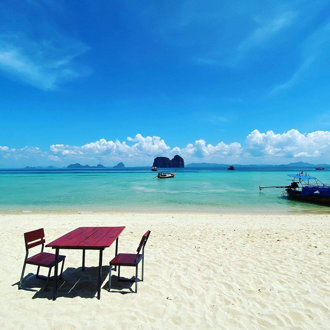Table with chairs on the main beach of Koh Ngai
