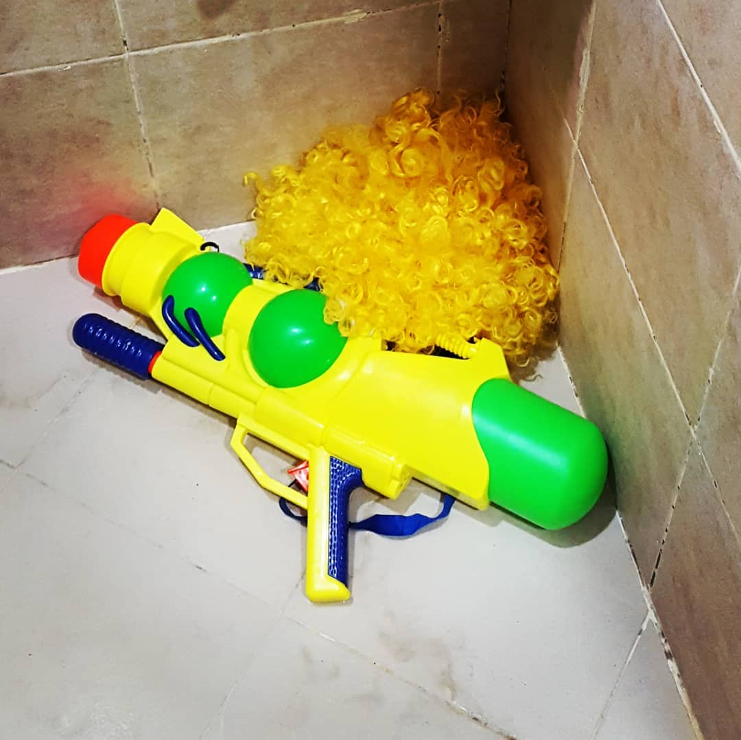 Wig and water gun after Songkran