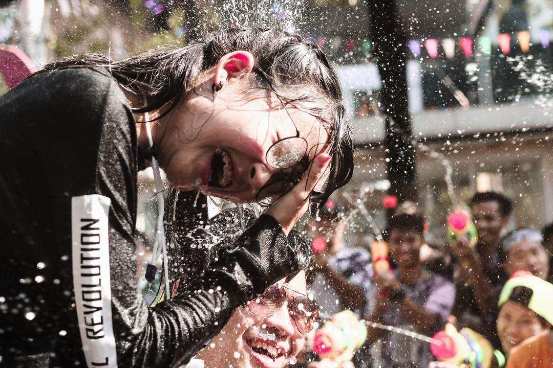 Wet sprayed girl during Songkran in Thailand