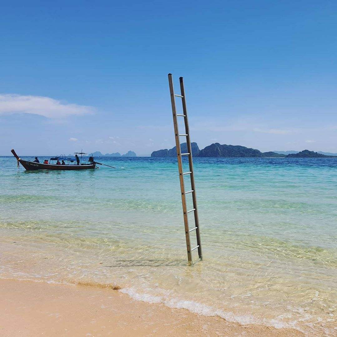 A ladder standing upright in the sea on Koh Kradan