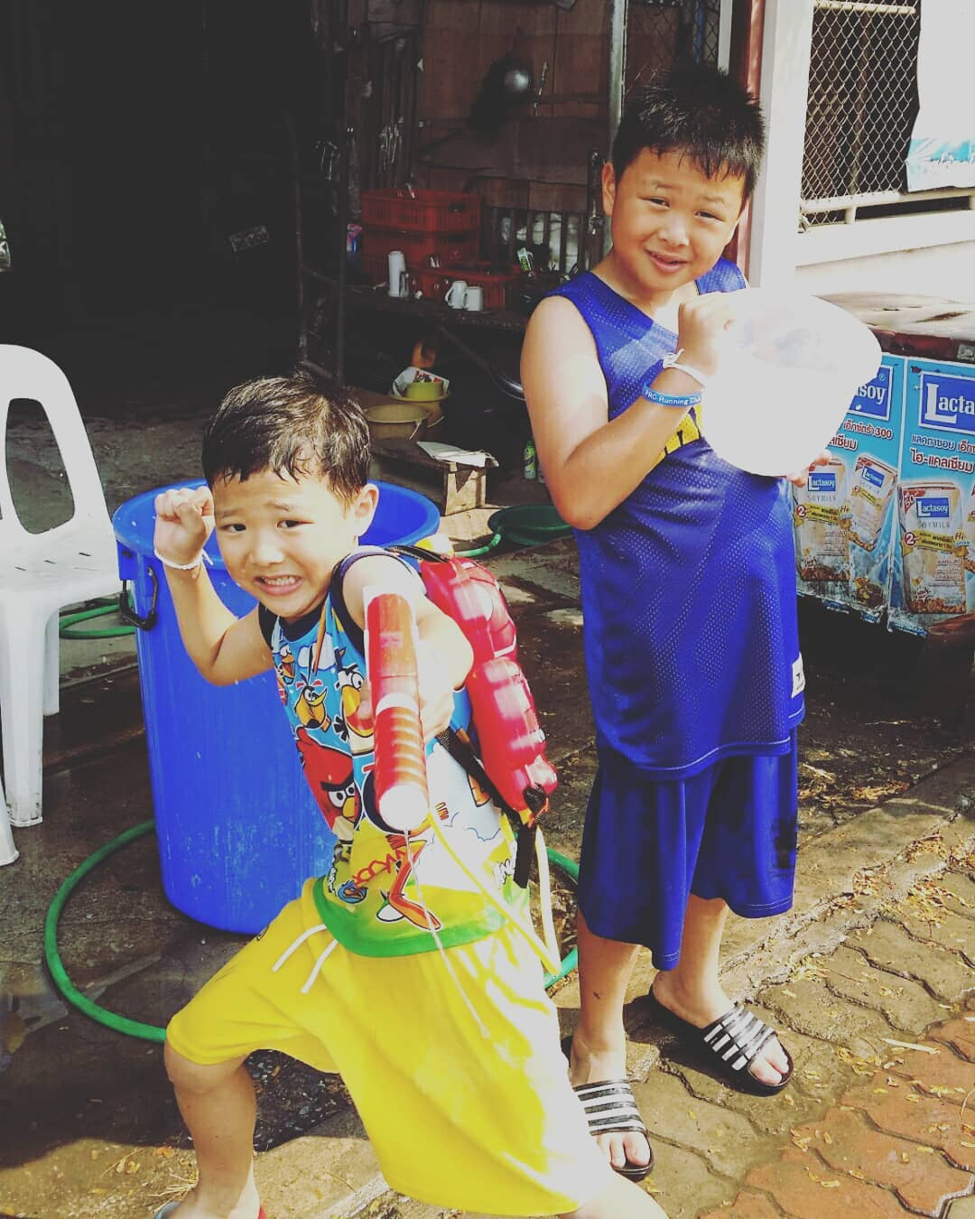 Two young boys during Songkran in Thailand