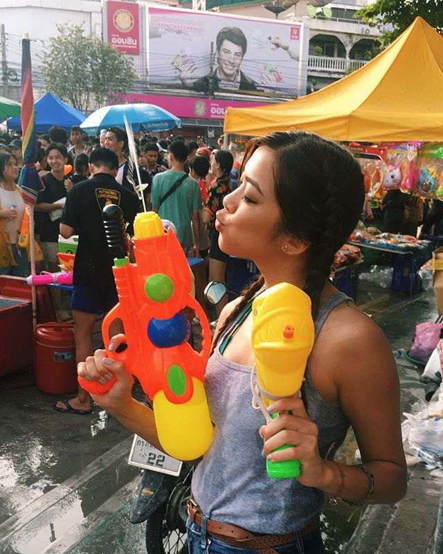 Girl with water guns during Songkran in Thailand
