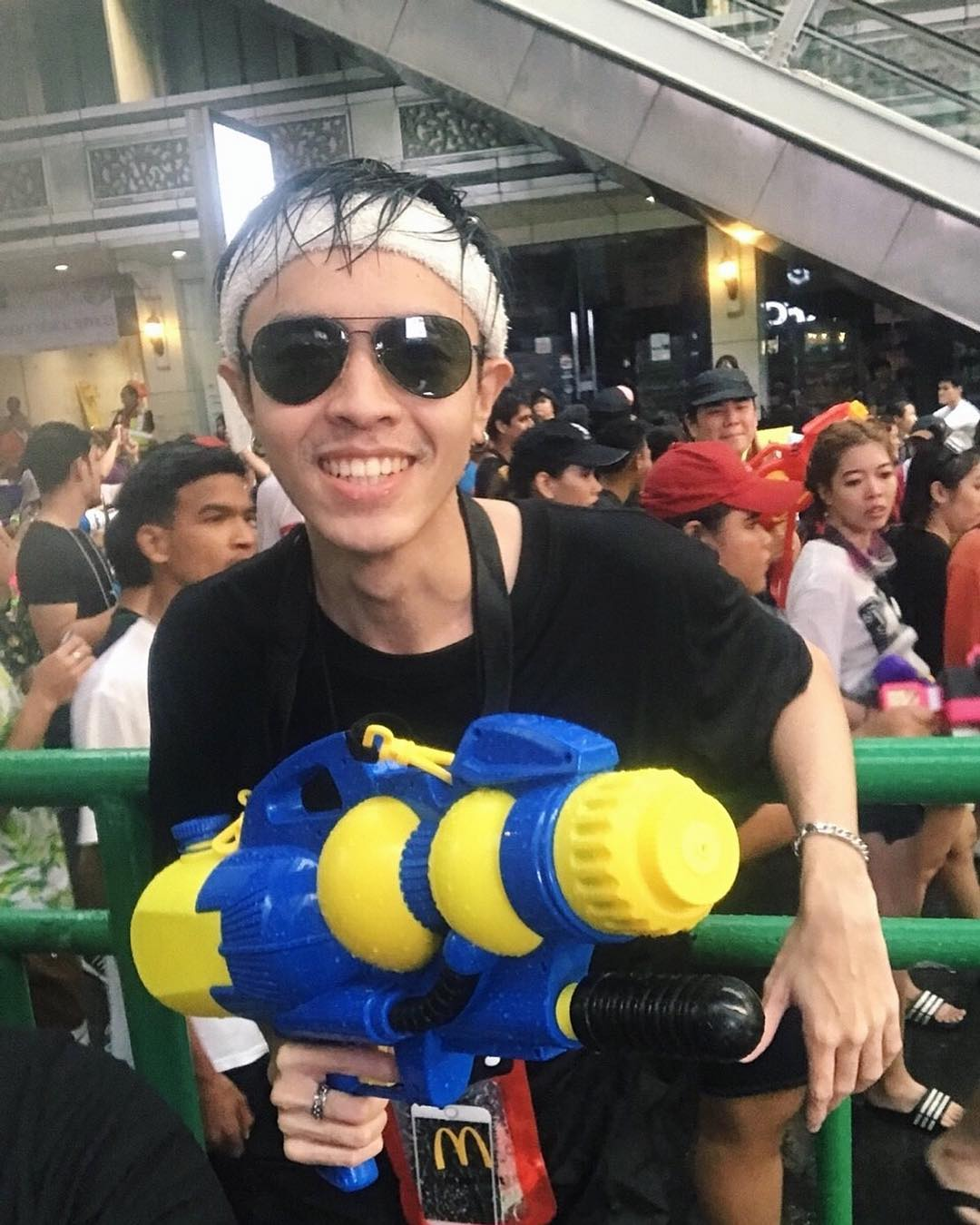 Boy with water gun during Songkran in Thailand