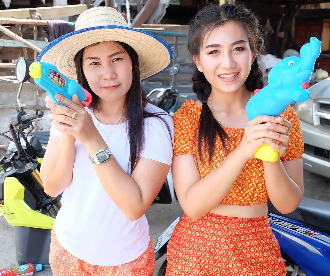 Two girls with water guns