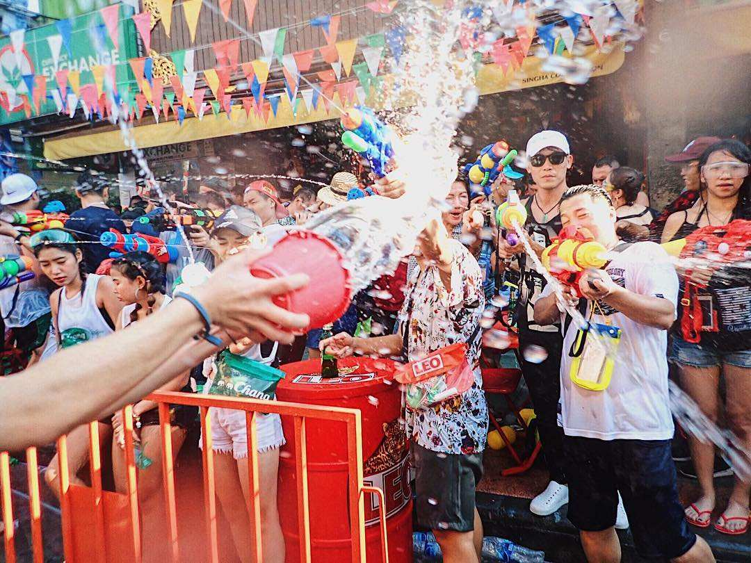 Water fight during Songkran on 13 April in Thailand
